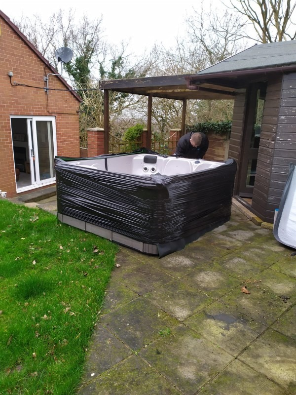 The clients hot tub all wrapped and ready to be moved